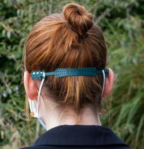 Green Ear Saver attached to Face Mask