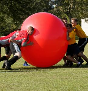 Sports team using a Mega Ball for a game